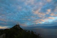 Zonsondergang op Goudklompjepunt, Catlins, Nieuw Zeeland stock foto