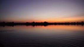 Zonsondergang op het meer stock video