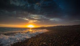 Zonsondergang op het strand Royalty-vrije Stock Foto