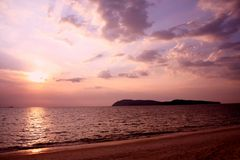 Zonsondergang op het strand Stock Afbeelding