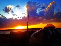 Zonsondergang op het water Stock Foto's