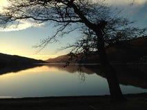 Zonsondergang op Loch Stock Foto