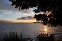 Zonsondergang op meer Taupo Stock Foto's