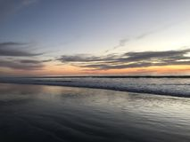 Zonsondergang op strand Royalty-vrije Stock Afbeeldingen