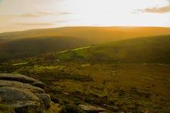 Zonsondergang over Dartmoor in Devon, het UK Stock Foto