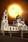 Zonsondergang over de kerk Stock Fotografie