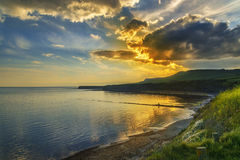 Zonsondergang over de klippen in Kimmeridge Royalty-vrije Stock Fotografie