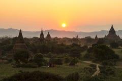 Zonsondergang over de tempels van Bagan, Myanmar Stock Foto