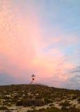 Zonsondergang over de vuurtoren Stock Afbeeldingen