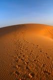 Zonsondergang over de woestijn van de Sahara Stock Afbeelding