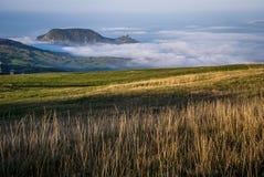 Zonsondergang over de wolken stock fotografie