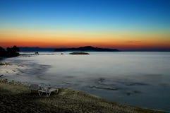 Zonsondergang over het overzees in Griekenland Stock Afbeelding
