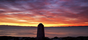 Zonsondergang over het Punt van de Stapel stock foto