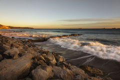 Zonsondergang over het strand Royalty-vrije Stock Foto