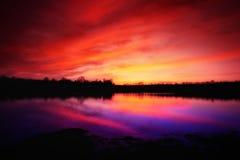 Zonsondergang over meer Royalty-vrije Stock Foto's
