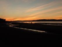 Zonsondergang over Moray Firth van Nairn-strand royalty-vrije stock foto