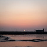 Zonsondergang over Morecambe-Baai, Lancashire, het UK stock foto's