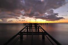 Zonsondergang over Overzees Stock Afbeeldingen