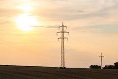 Zonsondergang over powerlines Royalty-vrije Stock Foto