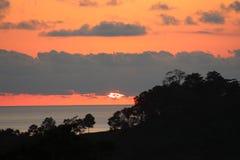 Zonsondergang over Quepos, Costa Rica stock foto's