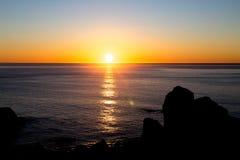 Zonsondergang over Vreedzame oceaan Stock Foto