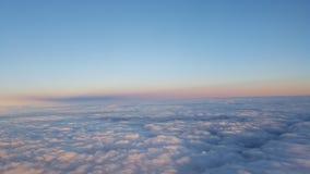 Zonsondergang over wolken Royalty-vrije Stock Foto's