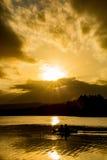 Zonsondergang Paddlers Royalty-vrije Stock Afbeeldingen
