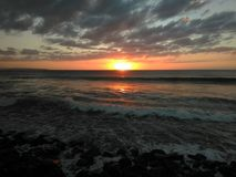Zonsondergang Playa Rompeolas Aquadillia Puerto Rico royalty-vrije stock afbeelding