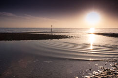 zonsondergang southbourne strand op een de wintersmiddag Stock Afbeelding