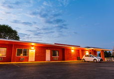 Zonsondergang in toeristisch motel De autoreis van de V.S. stock afbeeldingen