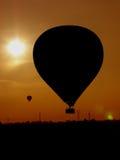 Zonsondergang van ballons Royalty-vrije Stock Afbeeldingen