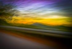 Zonsondergang van een bewegende auto Royalty-vrije Stock Foto's