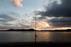 Zonsondergang visserij Stock Foto's