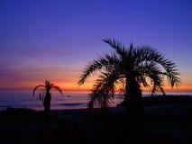 Zonsondergang in zeekust stock foto