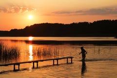 Zonsondergang zwemmer Stock Fotografie