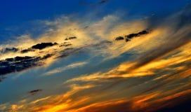 Zonsonderganghemel stock afbeeldingen