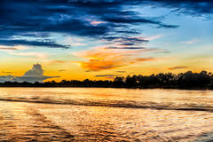 Zonsonderganglandschap over Zambezi rivier Stock Foto's