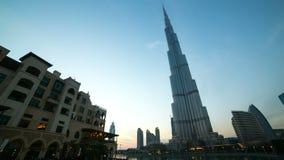 Zonsondergangmening dichtbij hoogste de bouw 4k tijdtijdspanne van Doubai stock videobeelden