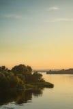 Zonsondergangmening over rivier Stock Foto