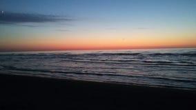 Zonsondergangoverzees stock afbeeldingen