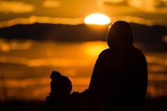Zonsondergangsilhouetten stock afbeelding
