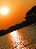 Zonsondergangzon met gele hemel Stock Foto