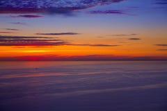 Zonsondergangzonsopgang over Middellandse Zee Royalty-vrije Stock Foto's