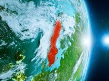 Zonsopgang boven Zweden op aarde Stock Afbeeldingen