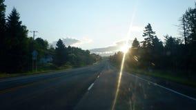 Zonsopgang op de weg stock foto's