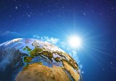 Zonsopgang over de Aarde stock foto's