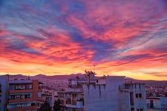 zonsopgang over de gebouwen in een buurt van de stad van Thes Stock Fotografie