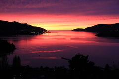 Zonsopgang over haven Lyttelton Stock Afbeeldingen