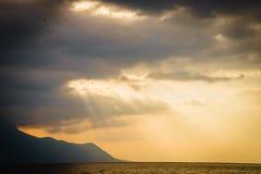 Zonstralen en Wolken Stock Afbeeldingen