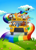 A zoo bus travelling through the rainbow road Royalty Free Stock Image